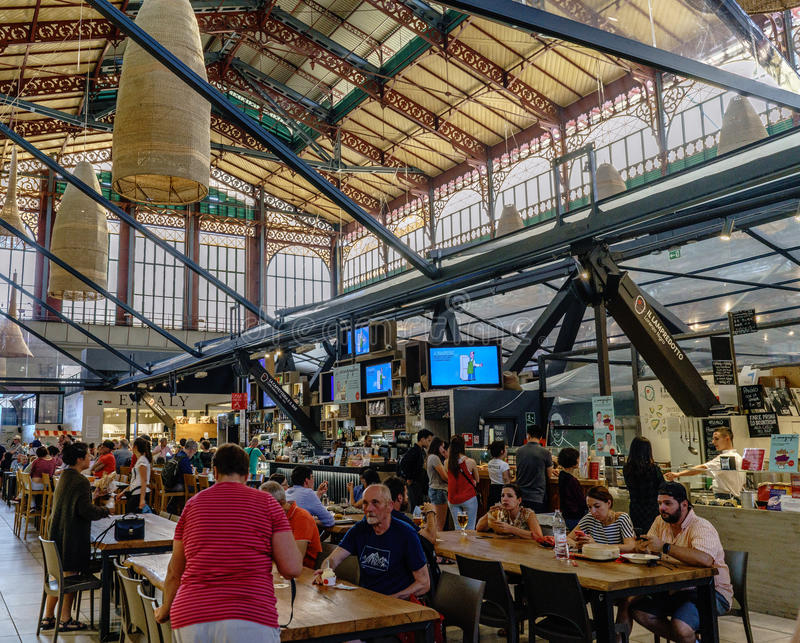 People visiting and eating in the famous central market of Florence called `Mercato centrale`. Florence, Tuscany, Italy. May 22, 2017: People visiting and eating royalty free stock photos