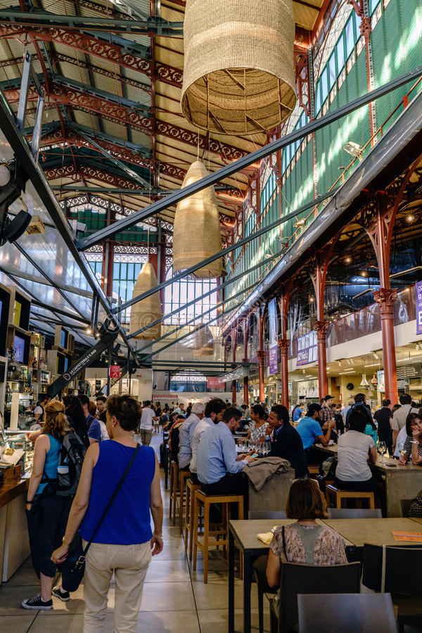 People visiting and eating in the famous central market of Florence called `Mercato centrale`. Florence, Tuscany, Italy. May 22, 2017: People visiting and eating royalty free stock image