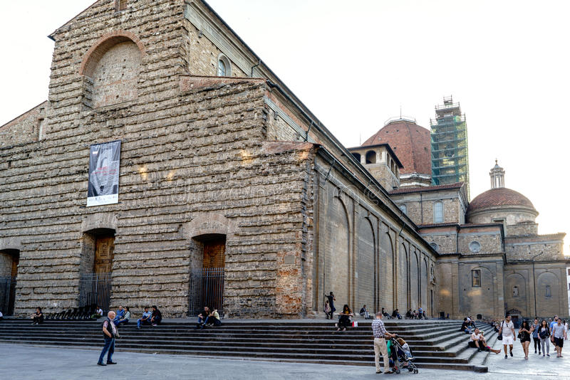 People walking in front of the Basilica called `San Lorenzo` in the place called San Lorenzo royalty free stock photos