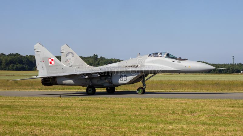 MiG-29 Fulcrum fighter jet taxiing. FLORENNES, BELGIUM - JUN 15, 2017: Polish Air Force MiG-29 Fulcrum fighter jet aircraft taxiing towards the runway of royalty free stock photography
