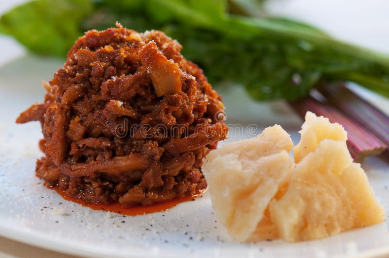 Florentine tripe in zimino with grated Parmesan cheese royalty free stock photo