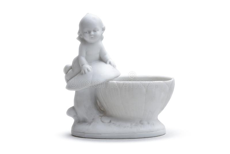 Florero blanco de la porcelana con un niño pequeño fotografía de archivo