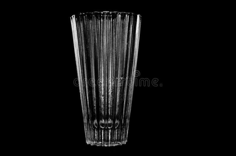 Florero en un fondo negro imagen de archivo libre de regalías