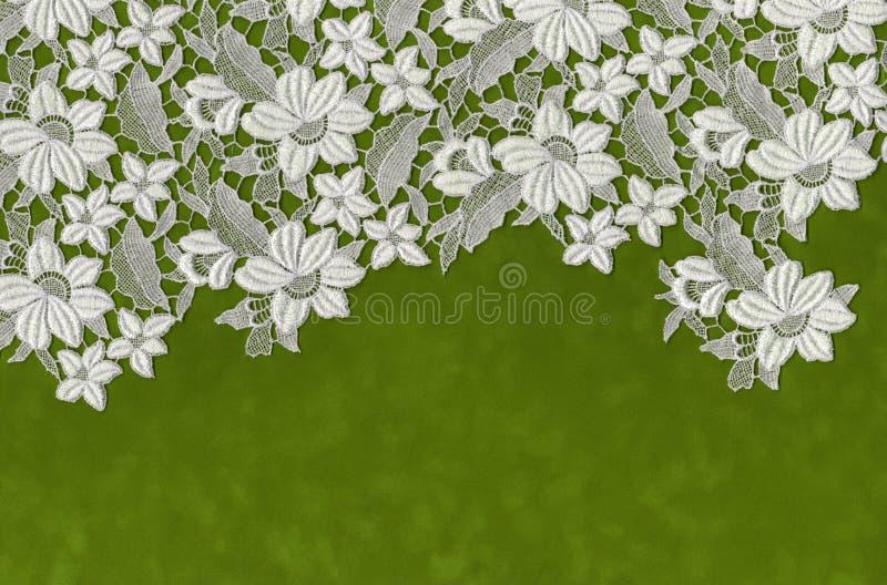 Flores bordadas puestas sobre el Libro Verde fotografía de archivo libre de regalías