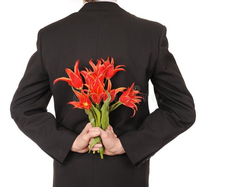 Flores da terra arrendada do homem fotografia de stock