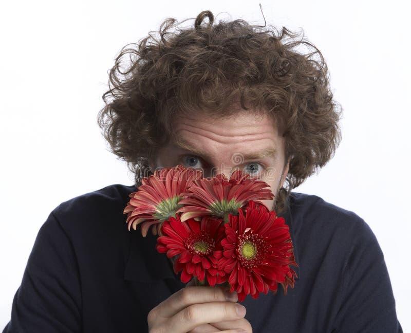 Flores da terra arrendada do homem imagem de stock