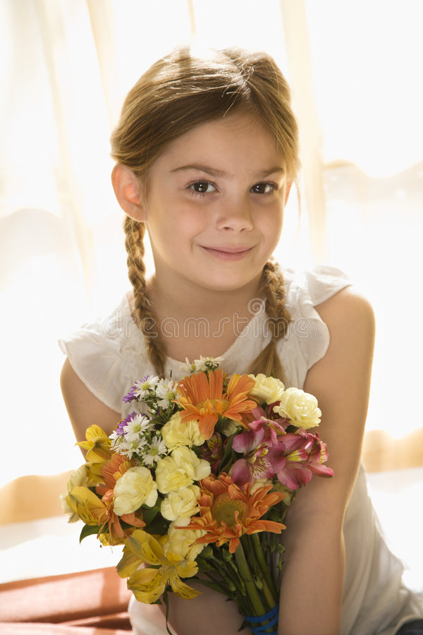 Flores de la explotación agrícola de la muchacha. imagen de archivo