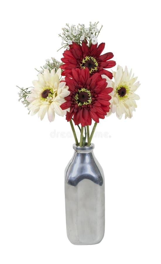 Flores de seda em um frasco de leite imagens de stock royalty free