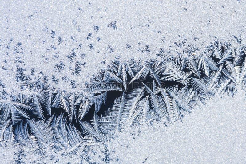 Flores del hielo sobre el vidrio - textura foto de archivo libre de regalías