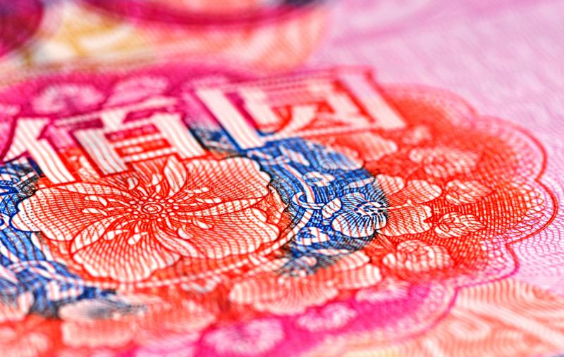 Flores en la nota de 100 RMB imagen de archivo