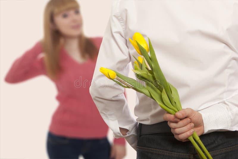 Flores escondendo do ramalhete do homem imagem de stock royalty free