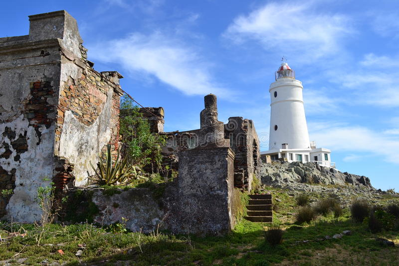 Flores island and his lighthouse. The Flores island, the lighthouse, and the ruins. Montevideo, Uruguay stock photography