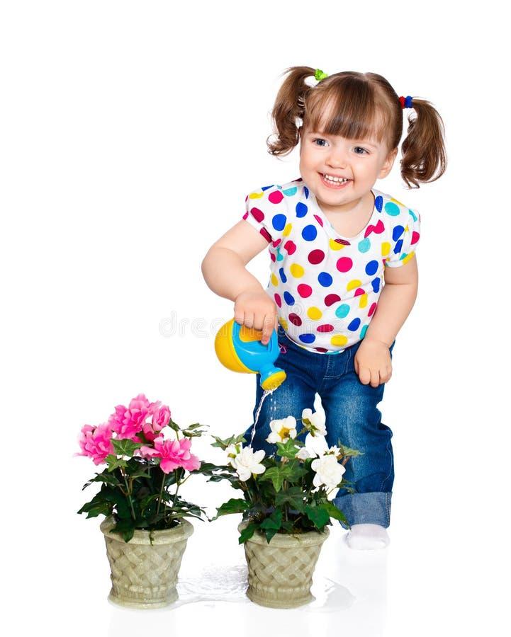 Flores molhando da menina fotos de stock royalty free