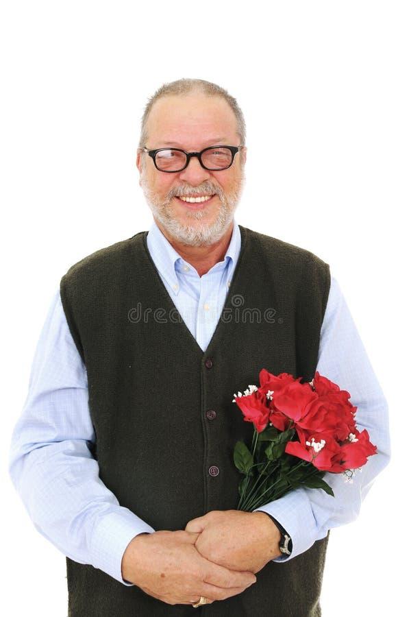 Flores vermelhas das rosas do homem imagens de stock