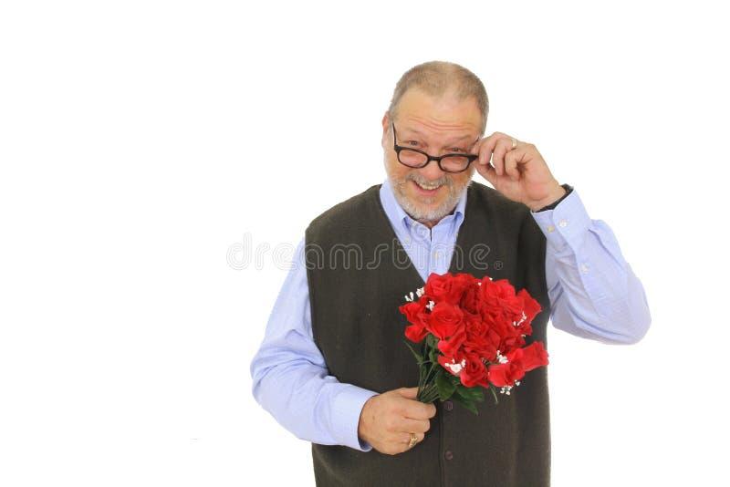 Flores vermelhas das rosas do homem fotos de stock royalty free