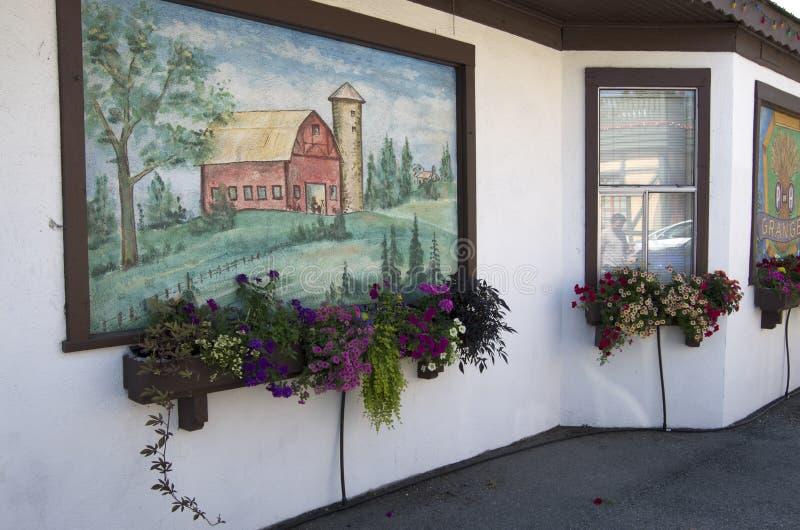 Flores y pintura de pared foto de archivo libre de regalías