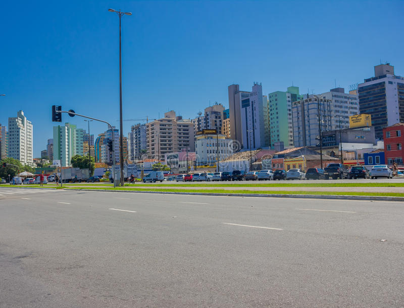 FLORIANOPOLIS, BRAZIL - MAY 08, 2016: lot of cars parked in an empty aveneu with the buildings skyline as background royalty free stock photography