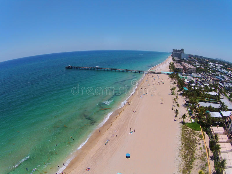 Florida beach and pier aerial. Sandy beach in SOuth Florida and fishing pier seen in aerial view stock photo