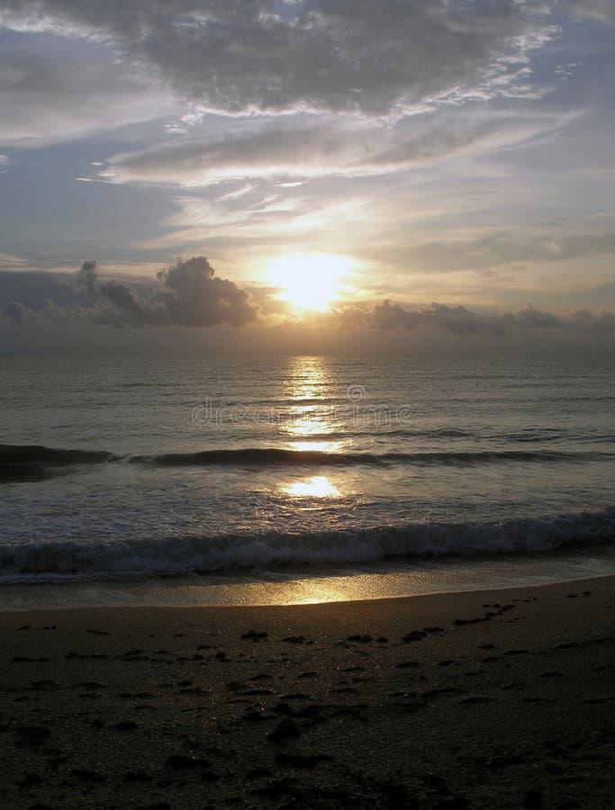 Florida Beach Sunrise. The sun shines on the beach of Florida royalty free stock photo