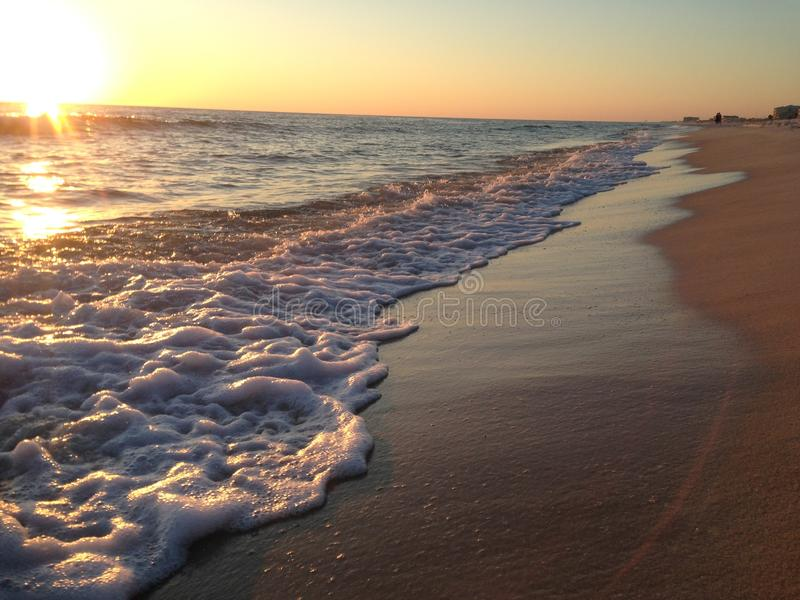 Florida Beach with Sunset and Waves royalty free stock images