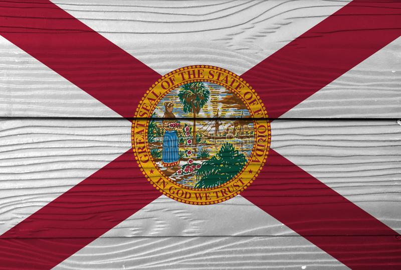 Florida flag color painted on Fiber cement sheet wall background, the states of America. A red saltire on a white background, with. The state seal superimposed royalty free stock photo