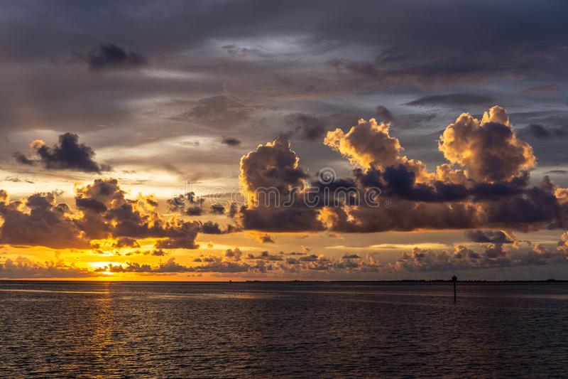 Florida gulf coast sunset after an evening thunderstorm. A beautiful Florida gulf coast sunset after an evening thunderstorm has passed through the area. Fort royalty free stock photo