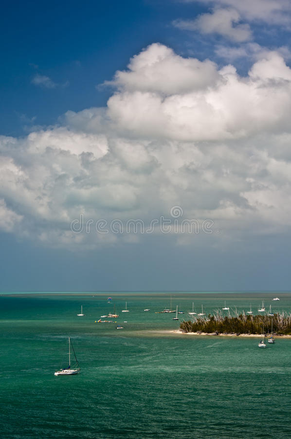Florida Keys. Sailboats anchor off an island in the turquoise blue waters of the islands, or Keys, located off the coast of the southern tip of Florida in the royalty free stock images