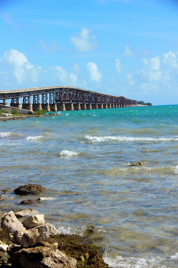 Florida Keys Causeway with the brilliant blue sea. Along the drive through the Florida, USA Keys. Brilliant blue seas, with a matching blue sky along the Gulf of stock images