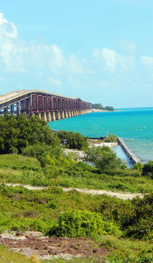 Florida Keys Causeway with the brilliant blue sea. Along the drive through the Florida, USA Keys. Brilliant blue seas, with a matching blue sky along the Gulf of royalty free stock photography