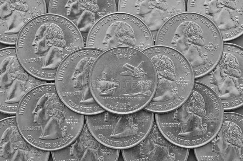 Florida State and coins of USA. Pile of the US quarter coins with George Washington and on the top a quarter of Florida State royalty free stock photography