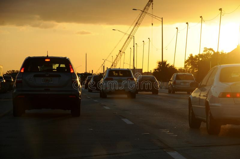 FLORIDA TRAFFIC DURING SUNSETS. CAPE CANAVERAL / FLORIDA / USA - 06 December 2017.-Florida jam traffic during sunsets . Photo.Francis Dean/Dean Pictures royalty free stock photography