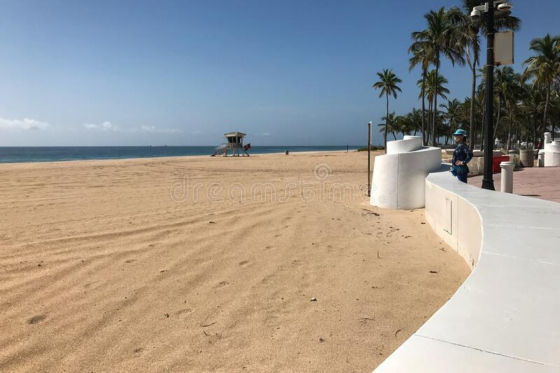 Florida Woman Wearing Mask Observes Empty Fort Lauderdale Beach stock images