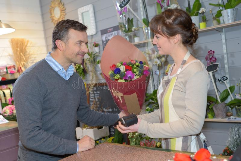 Florist and customer completing sale. Sale royalty free stock photos