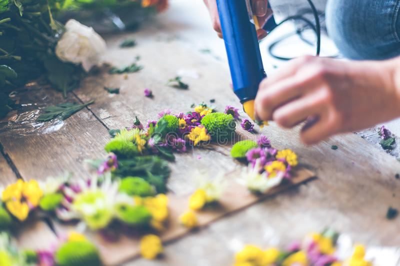 Florist making flower decoration stock photography