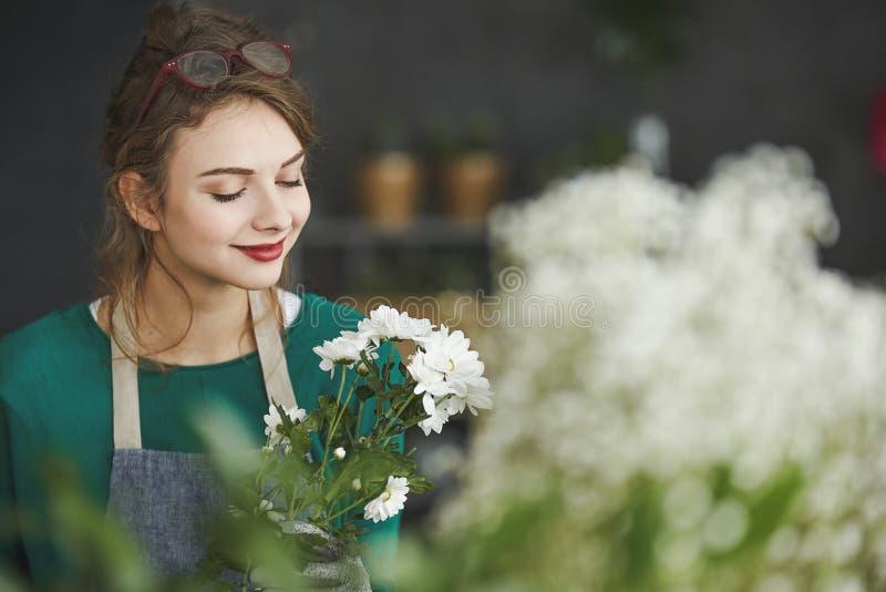 Florist smelling flowers stock photos