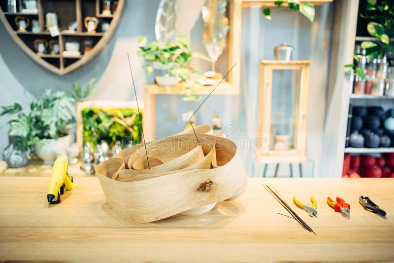 Florist tools on the table in flower shop, nobody. Decoration materials, professional floristic equipment. Glue gun, cutter, gardening scissors stock images