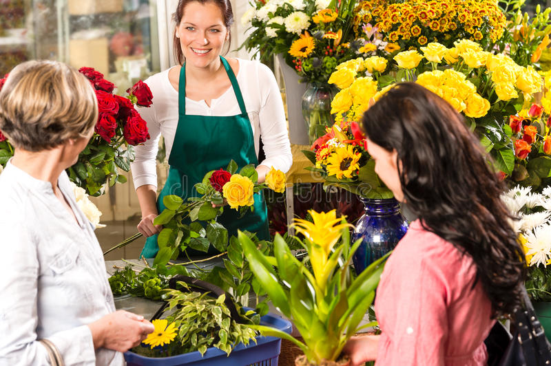 Florist woman preparing bouquet customers flower shop royalty free stock image