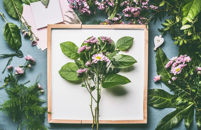 Florist work space . Flowers arrangement with green branches and pink flowers stock photo