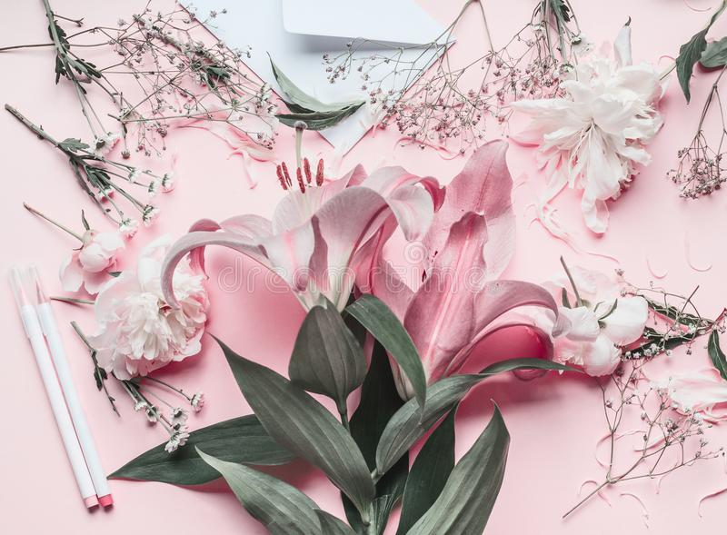 Florist work space with pastel pink lilies flowers royalty free stock photo