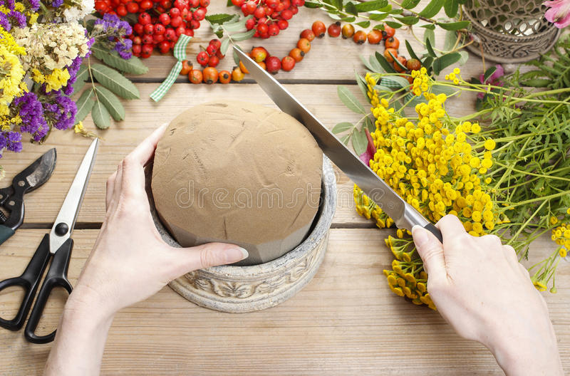 Florist At Work: Woman Using Floral Foam Stock Photo