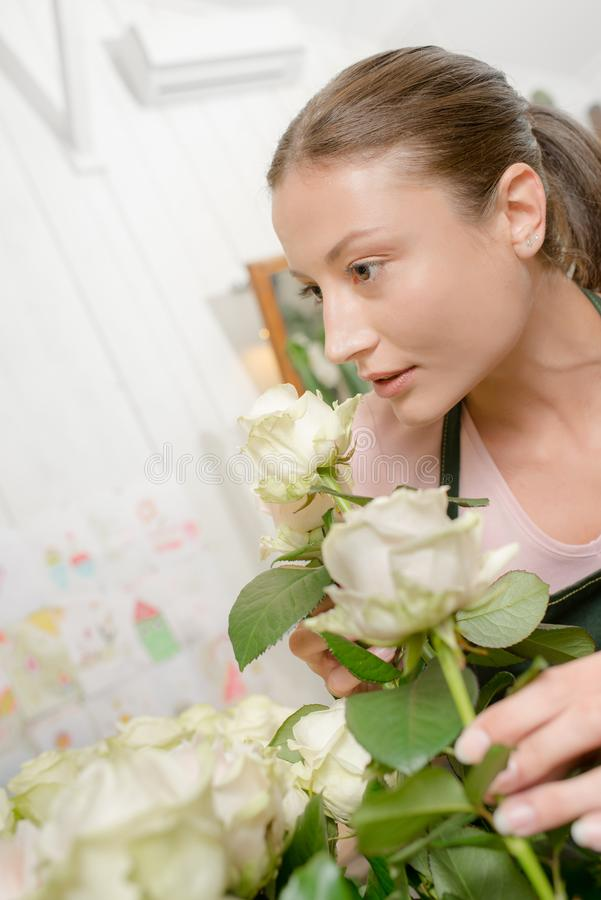 Florist worker smell flowers royalty free stock photos