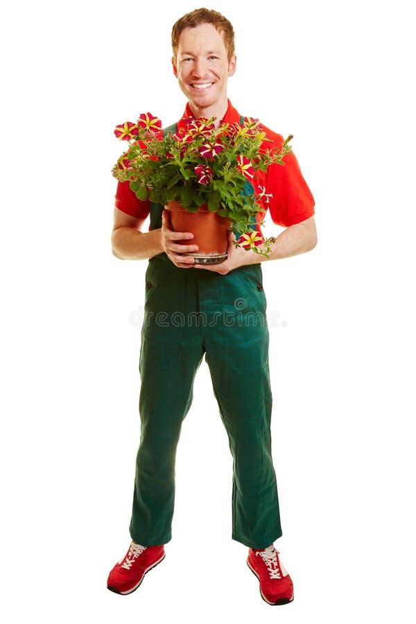 Florista con un verde total foto de archivo libre de regalías