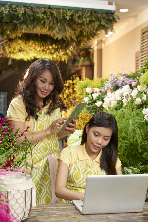Florists working on order royalty free stock photos