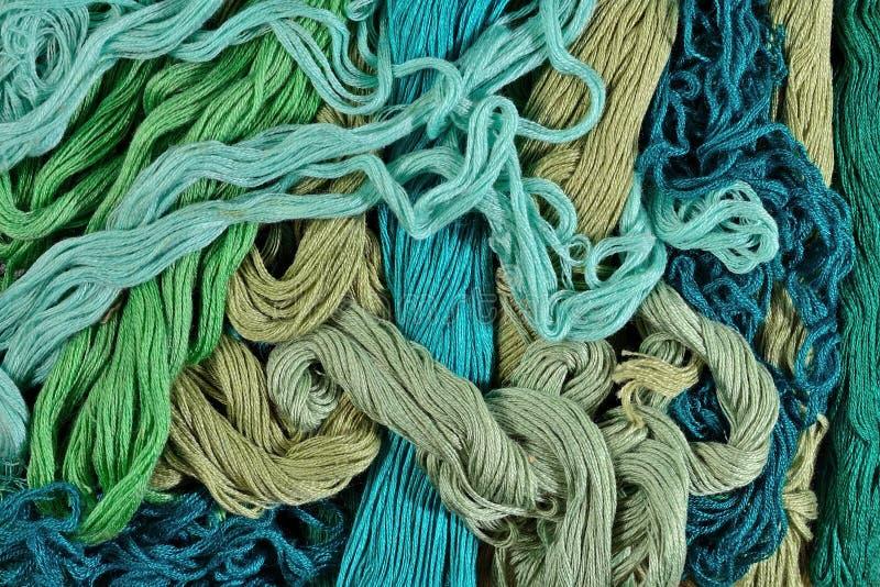 Floss colorido do bordado como a textura do fundo foto de stock
