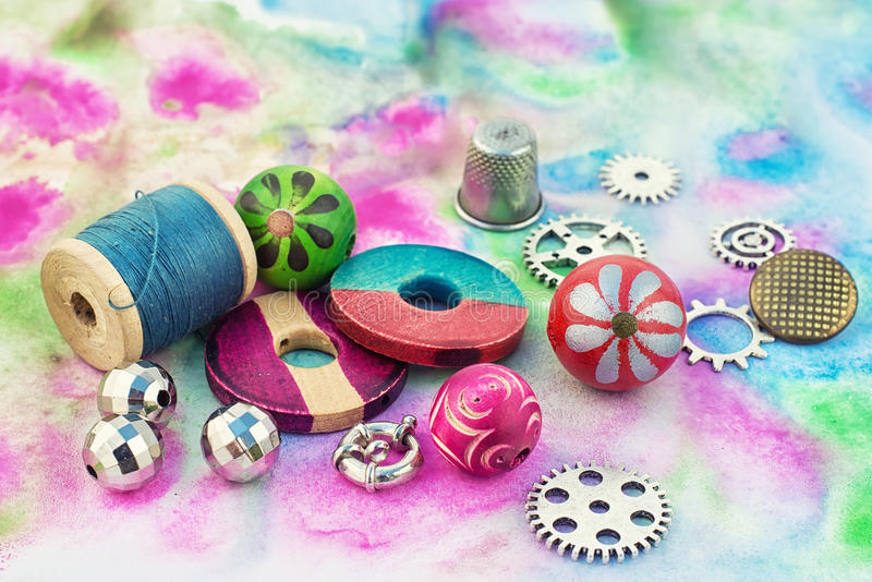 Floss and trinkets for needlework stock images