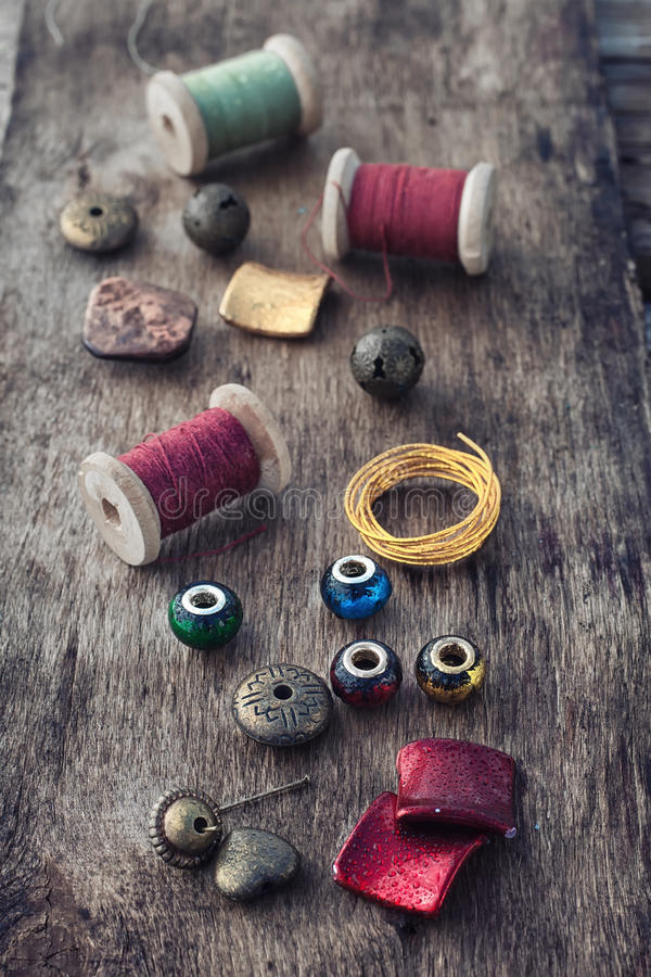Floss and trinkets for needlework stock image