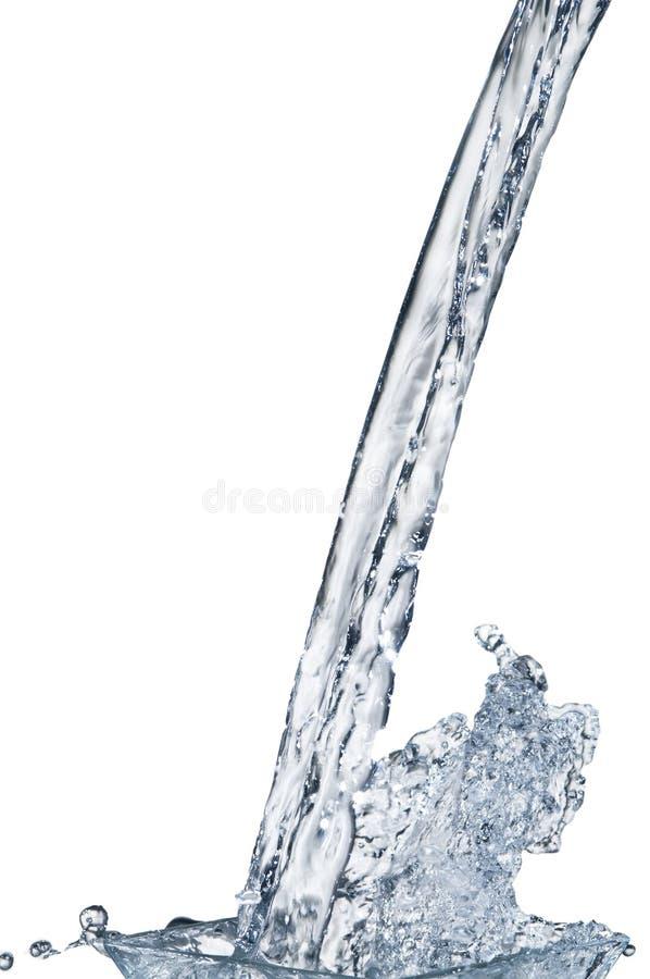 Flot de l'eau avec l'éclaboussure sur le blanc photo libre de droits