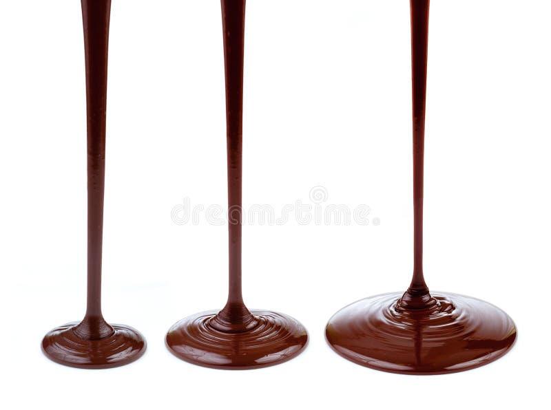 Flot ou flux de chocolat chaud d'isolement photo libre de droits