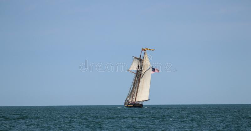 A flotilla of historic tall ships, sailing on Lake Erie in the summer. stock photo