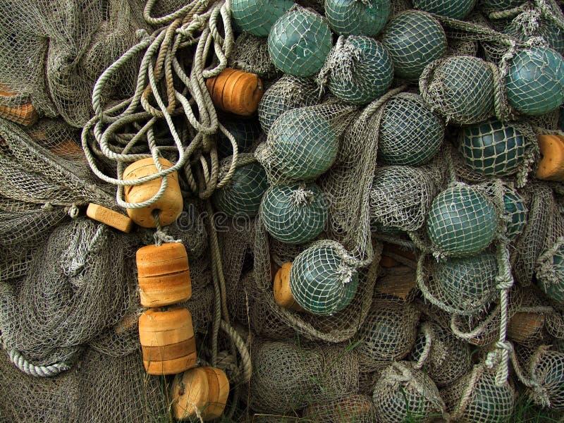Flotteur en verre, vieux filets de pêche photos stock